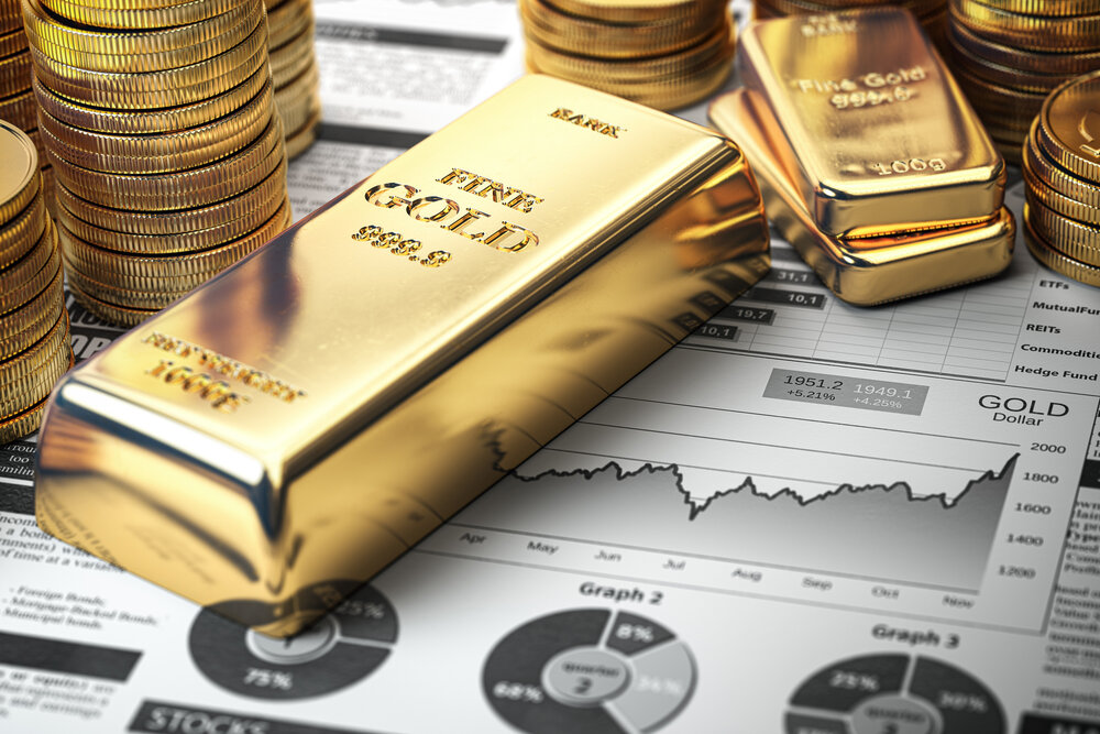 Gold bar, ingots and coins on financial report.